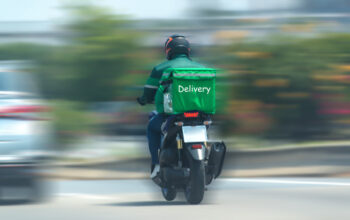 Food delivery drivers are driving to deliver products to customers who order online. Impact of epidemics